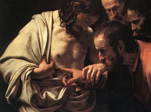 Thomas puts his finger in Jesus' side to prove He's alive.