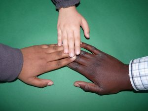 Though we come from different backgrounds, we are united in Christ as His church.