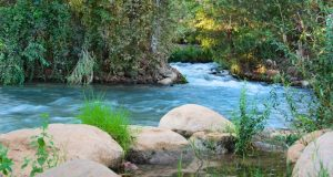 During the rainy season, the Jordan River's current is very deep and swift.