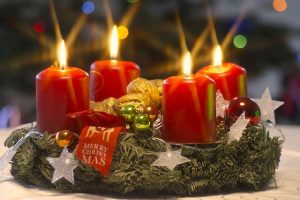 Advent wreaths usually have four candles around the perimeter and one white candle in the center.